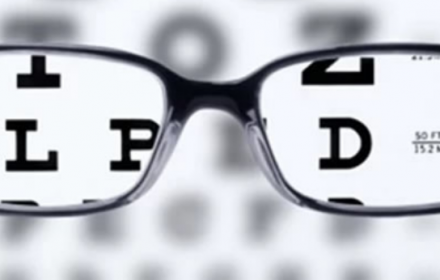 Graphic image of visual eye test and reading glasses
