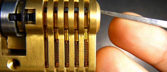 Lockpicking tools inserted into lock